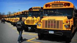 A file photo of students boarding school buses