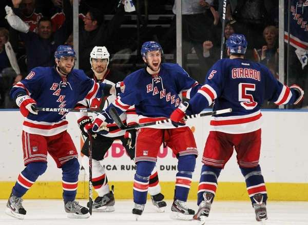 Dan Girardi celebrates his third period goal with