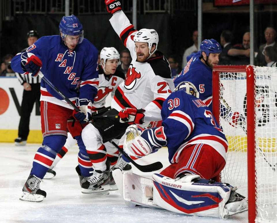 Ryan McDonagh defends as New Jersey Devils right