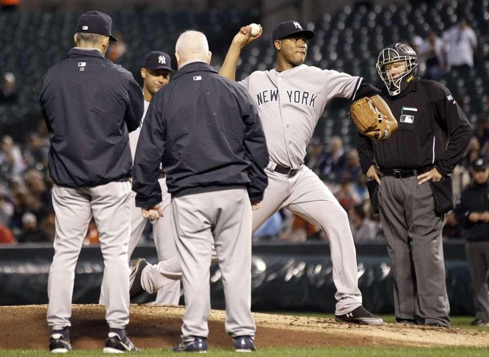Yankees starting pitcher Ivan Nova, second from right,