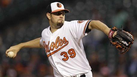 Baltimore Orioles starting pitcher Jason Hammel throws to
