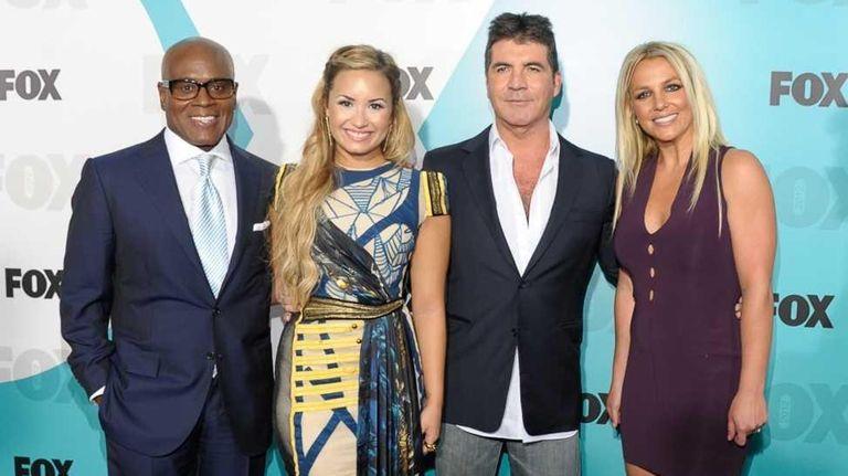 L.A. Reid, left, Demi Lovato, Simon Cowell and