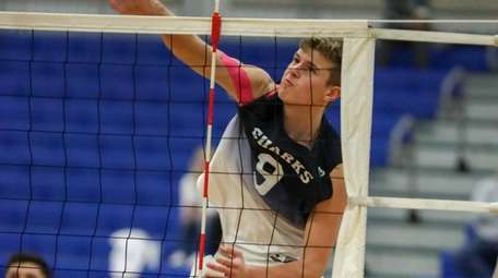 Adam Burk of Eastport-South Manor spikes the ball