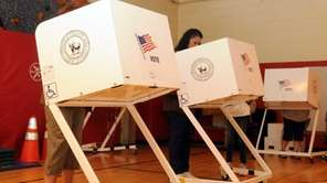 Residents vote at Connetquot Elementary School in Islip