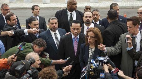 Former State Senator Pedro Espada Jr. walks out