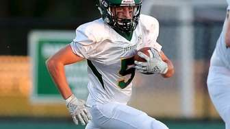 Ward Melville WR Steven Germain takes the ball