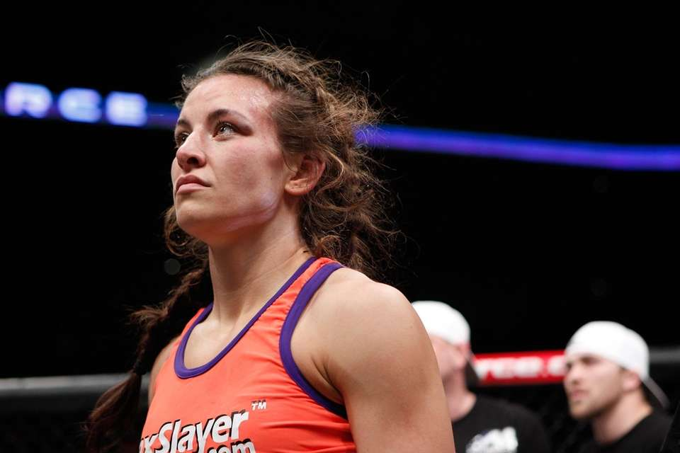 Miesha Tate reacts after losing her Strikeforce women's