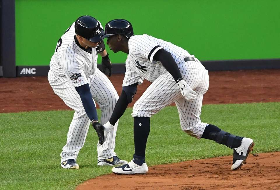 New York Yankees' Didi Gregorius, right, is greeted