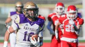 Sayville's Brock Murtha (12) runs in a touchdown