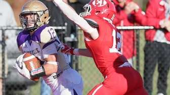 Sayville's Brock Murtha (12) catches a touchdown pass