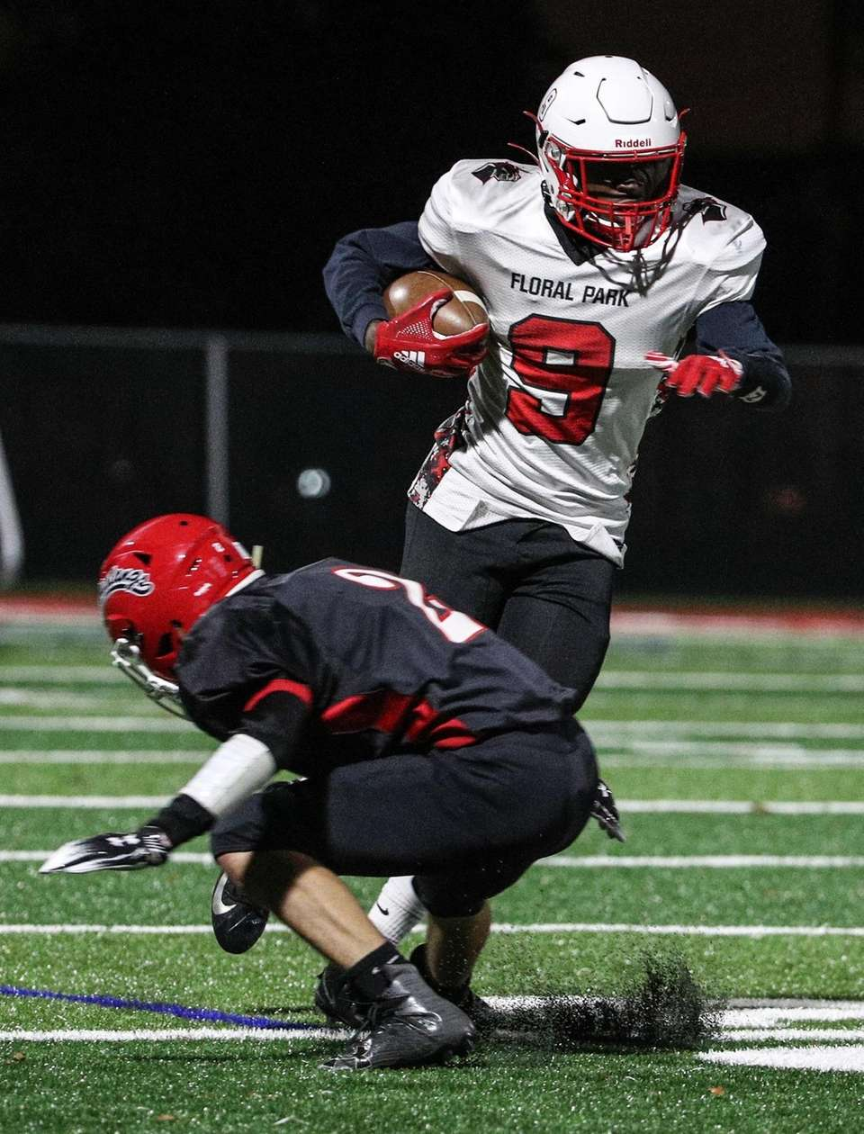 Taliek Nelson of Floral Park cuts back behind