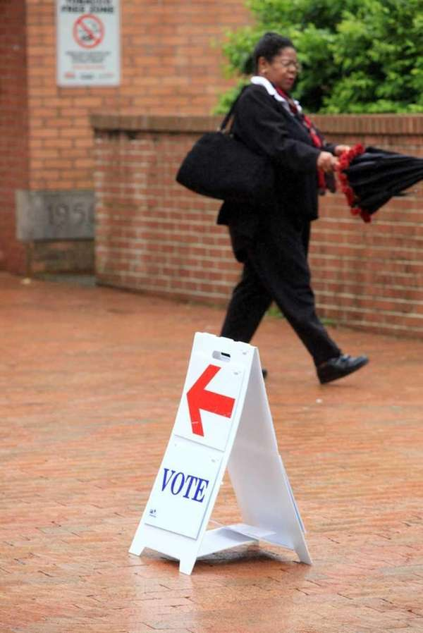 A voter leaves the polling place at Spring