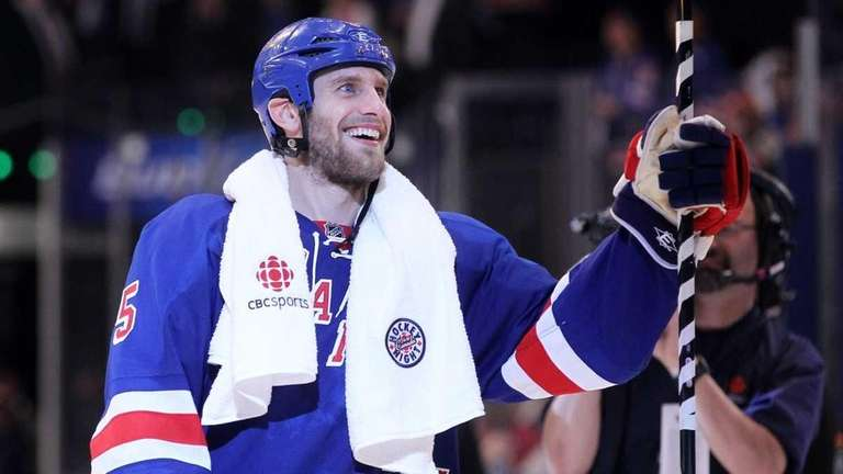 Dan Girardi acknowledges the crowd after the Rangers