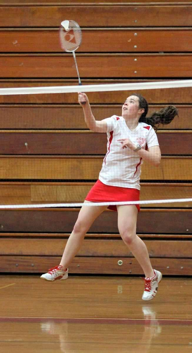 Sacred Heart's Nally Ann Scaturro returns the volley