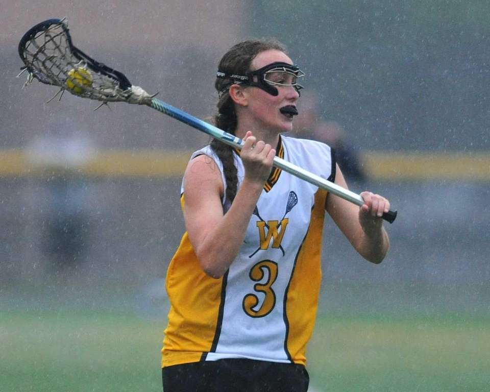 Wantagh's Colleen Lovett looks to pass in the