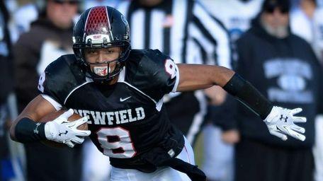 Newfield's Elijah Riley breaks through the defense on