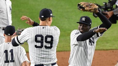 Yankees' Aaron Judge and Didi Gregorius, right, celebrate