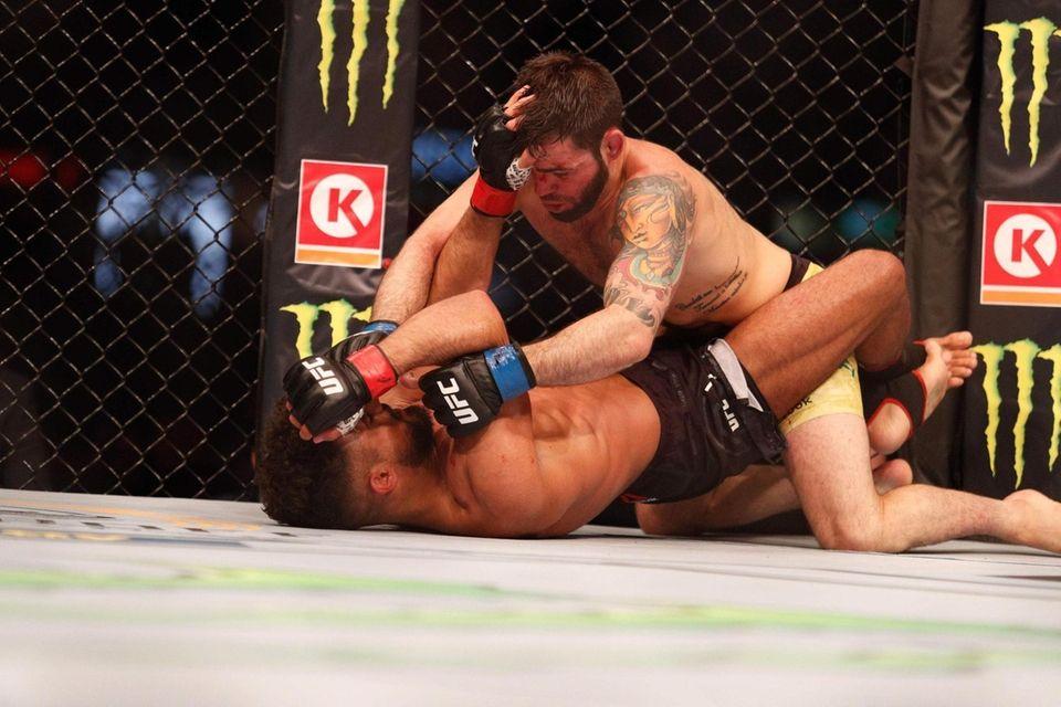 Bruno Silva of Brazil (R) pins down Khalid