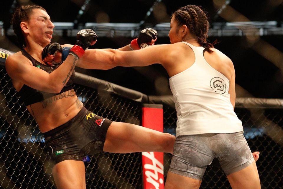 Nadia Kassem of Australia (L) gets punched by