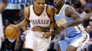 Oklahoma City Thunder guard Russell Westbrook, left, drives