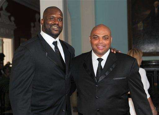 Basketball players Shaquille O'Neal, left, Charles Barkley attend