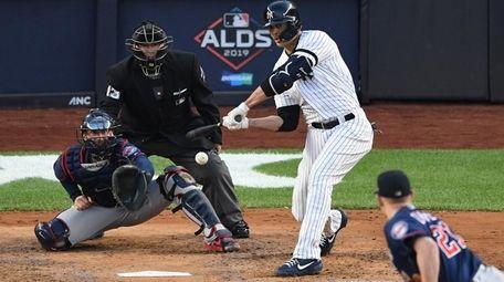 New York Yankees' Giancarlo Stanton hits a sacrifice