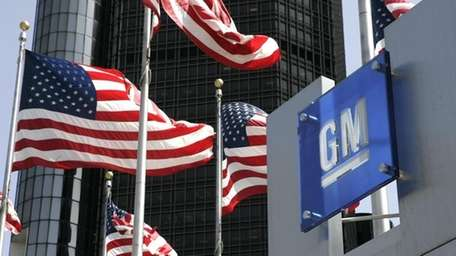 U.S. flags are shown outside of General Motors