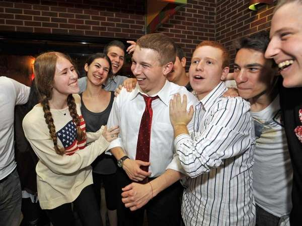 Joshua Lafazan, center, celebrates with friends and classmates