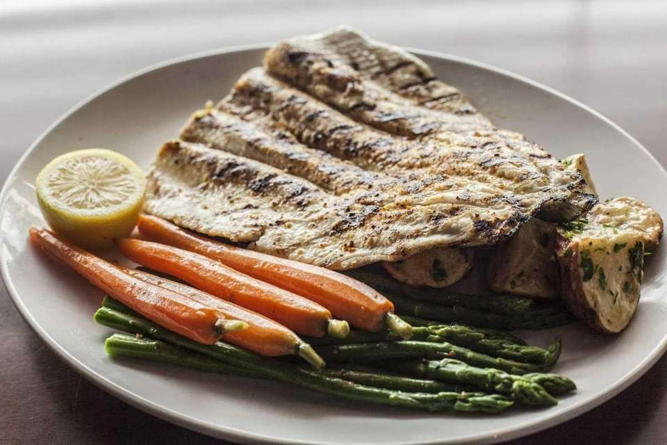 Seasons 52's rainbow trout, cooked over a wood-burning