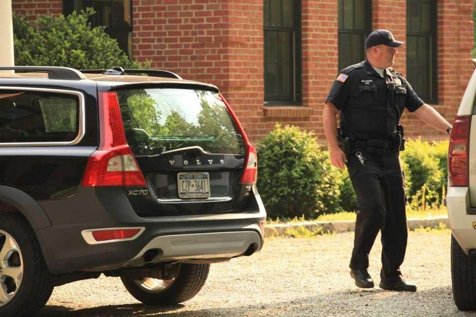 Bedford Police Officer Andrew Klein walks out of