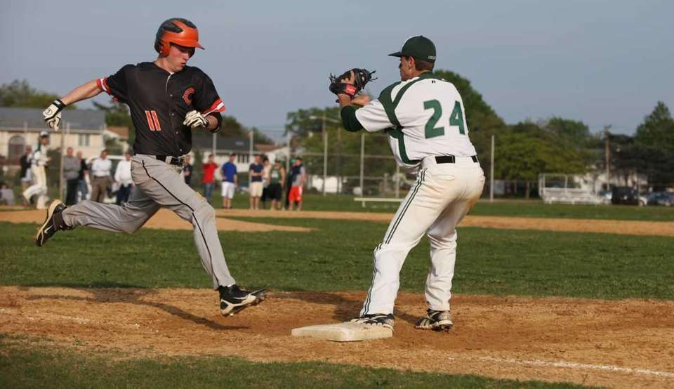 A throw to Bellmore JFK's David Leiderman, right,