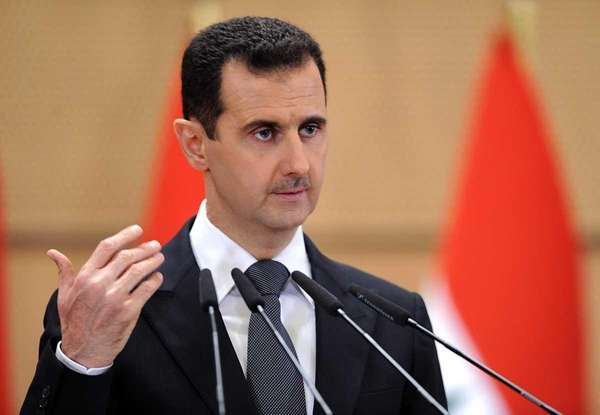 Syrian President Bashar Assad delivers a speech in
