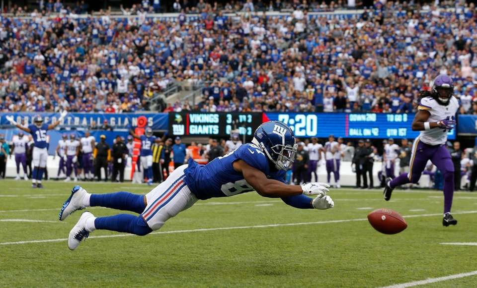 Sterling Shepard of the Giants dives for an