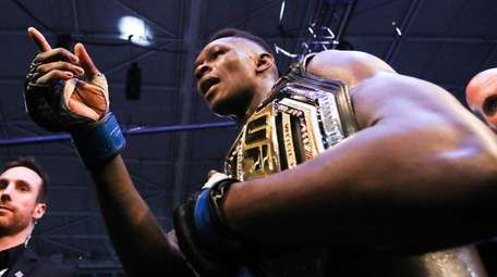 Israel Adesanya of New Zealand celebrates after defeating