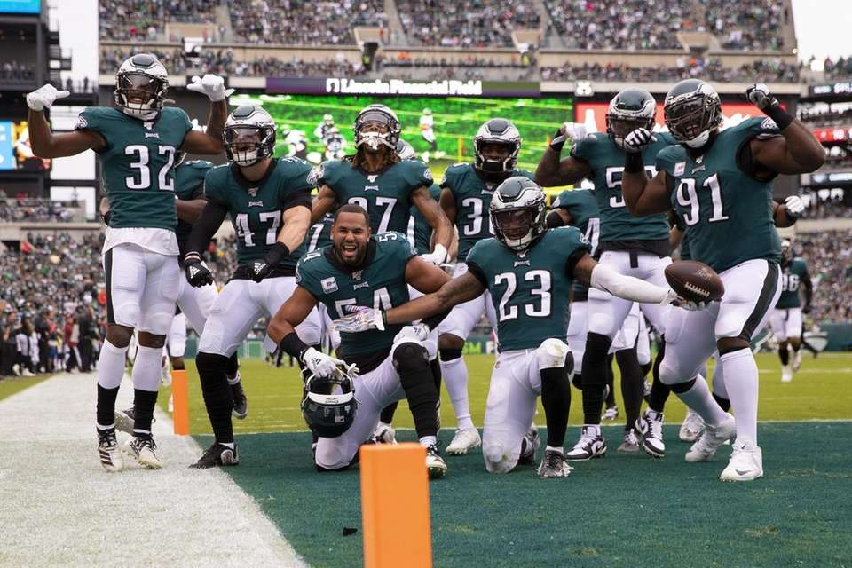 The Philadelphia Eagles defense pose for a picture
