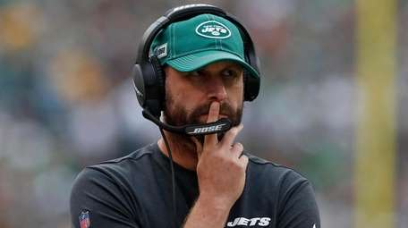 Jets head coach Adam Gase looks on from