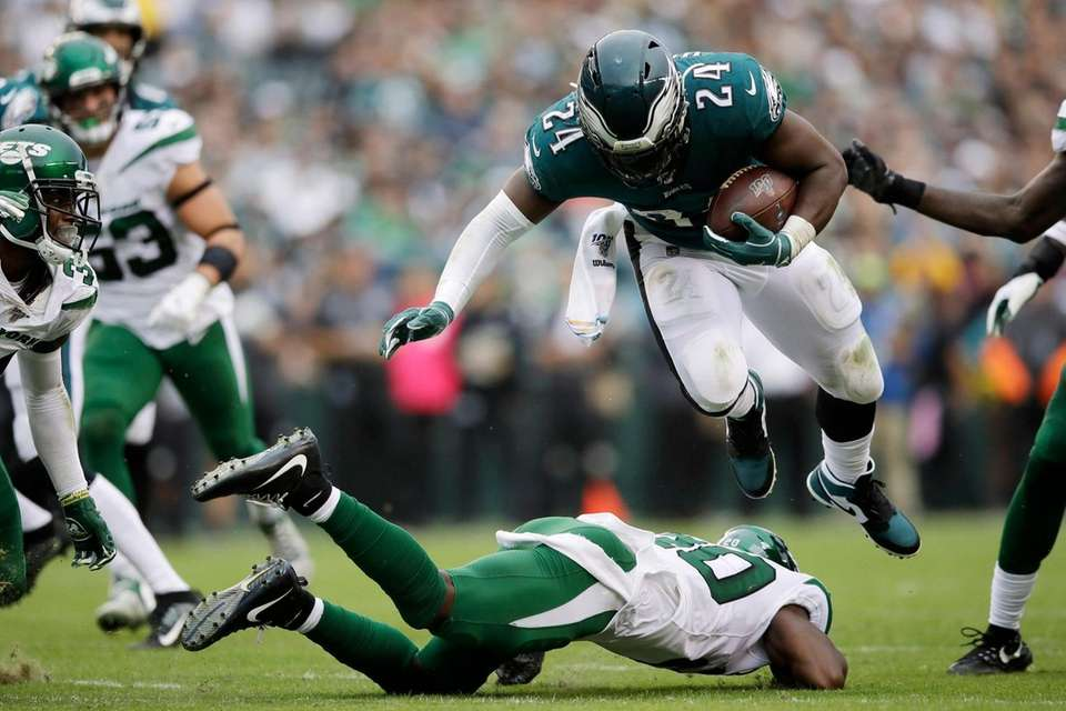 Philadelphia Eagles' Jordan Howard, right, is tackled by