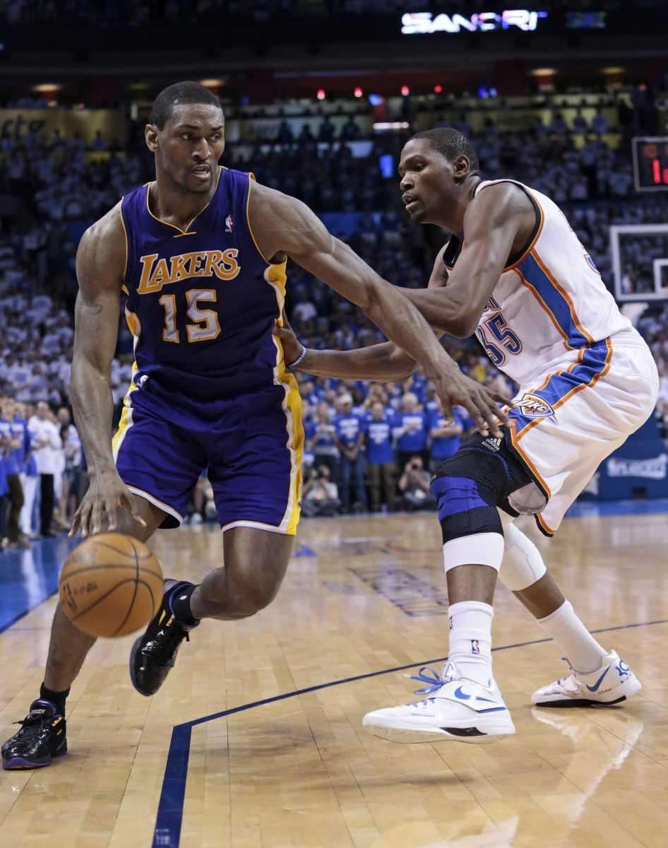 Los Angeles Lakers forward Metta World Peace, left,