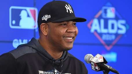 Yankees DH Edwin Encarnacion speaks to the media