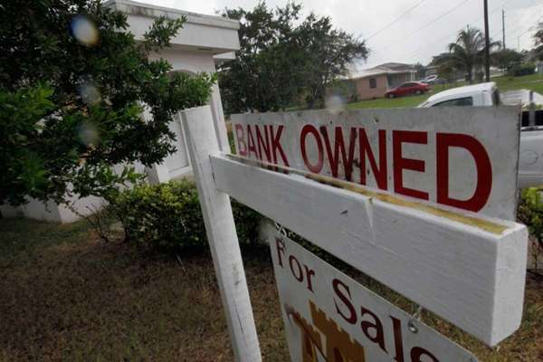 Bank-owned signs in front of homes have become