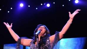 Donna Summer performs on stage in Berlin. (July