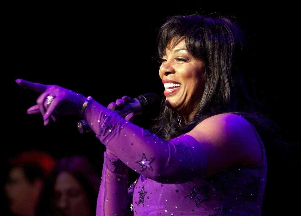 Donna Summer performs at a concert at Jones