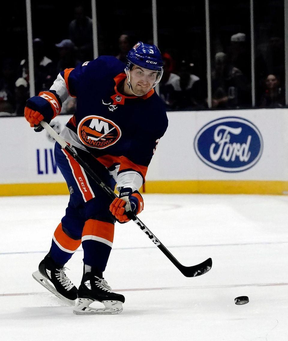 Islanders defenseman Adam Pelec sends the puck into