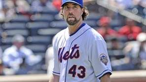 R.A. Dickey walks off the mound in the