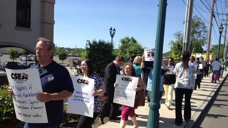 Unionized Rockland County workers protest outside State Sen.