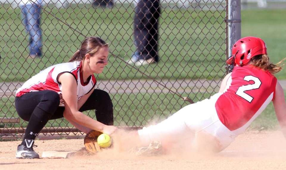 Plainedge's Kate Finnen beats the tag from Floral