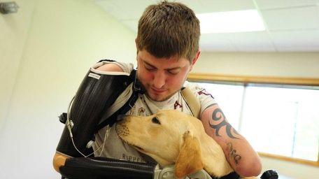 Marine Corps Sgt. John M. Peck, 26, hugs