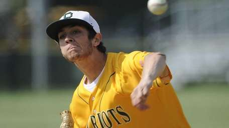 Ward Melville pitcher Anthony Kay delivers against Hauppauge