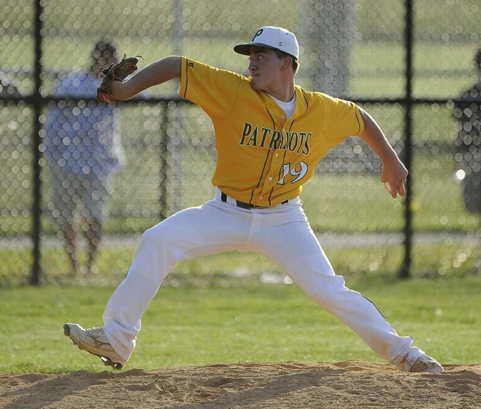 Ward Melville pitcher Gregory Coman delivers in the