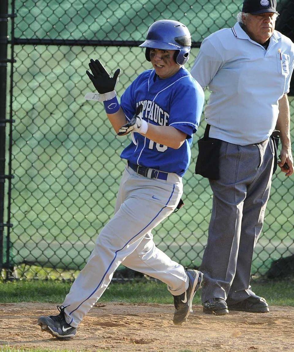 Hauppauge's Austin Adamo scores in the tenth inning